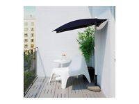 Small black adjustable garden parasol with cover, nearly new (from IKEA)