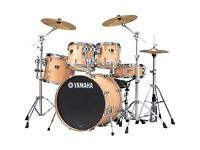 Yamaha Stage Custom five piece drum kit. Including Mapex cases Sabian cymbals and Premier stool.