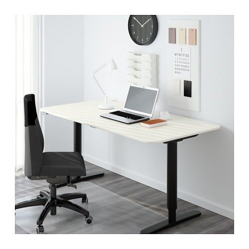 "IKEA ""BEKANT"" desk with screen, height adjustable desk with a black frame and white top"