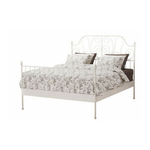 White metal bed frame from Ikea with queen sized mattress