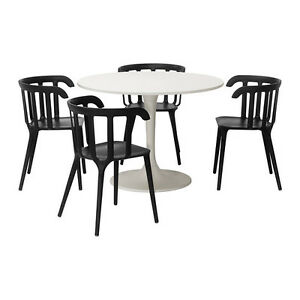 Docksta Table + 4 Chairs - only months old!