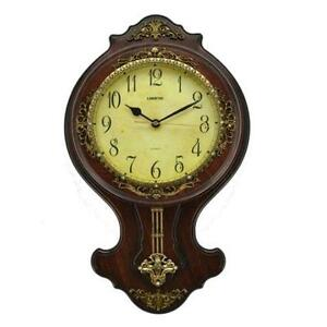 pendulum at clock hut online brown music wall shape buy accurate watches