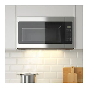 Brand new over-the-range Microwave with extractor fan