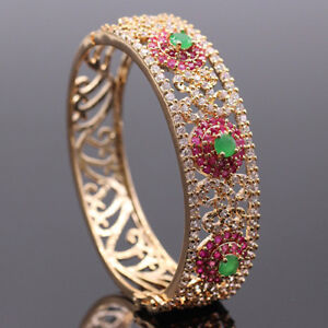 High end bangle bracelet, created ruby and emerald stones