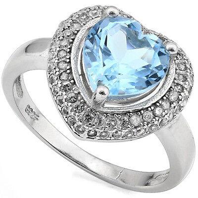 - 2.63 CTW BABY SWISS BLUE TOPAZ & DIAMOND PLATINUM OVER 925 S.SILVER HEART RING