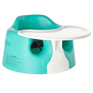 Teal colored  bumbo chair with straps and tray