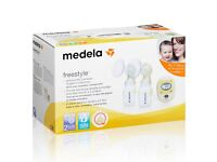 Medela freestyle double electric breast pump with extras