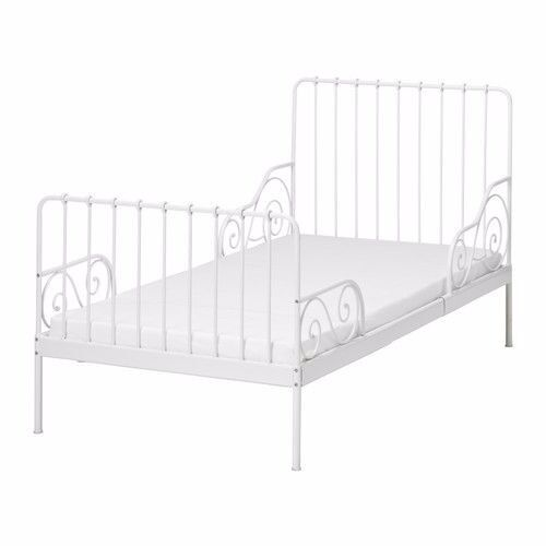 Single white IKEA Minnen ext. bed.