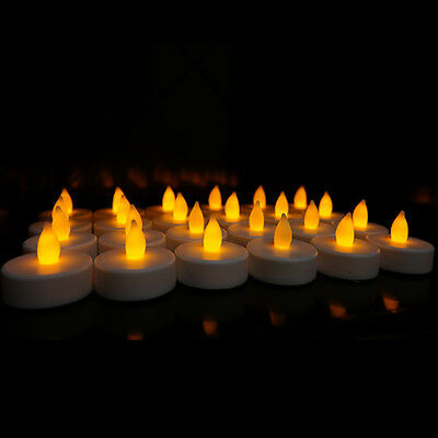 24 Flameless Battery Christmas LED Tea Light Flickering Amber Tealights Candles