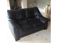 Black leather suite comprising 2 x 2 seater sofas and a chair. Excellent quality leather by Tetrad