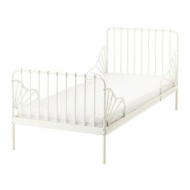 White Ikea extending toddler bed with mattress