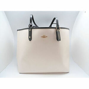 5ddb99b976 ... cheap coach signature reversible city tote travel pouch black chalk  white 8dccf 50b83