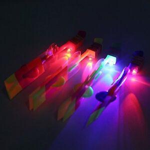 UK 10pcs Flying Rotating Rocket Helicopter Flash LED Light Toy Fun Elastic Gift