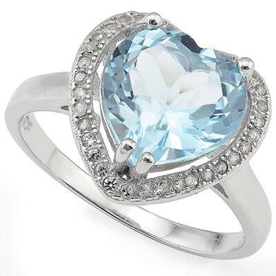 - 4.22 CTW BABY SWISS BLUE TOPAZ & DIAMOND PLATINUM OVER 925 S.SILVER HEART RING