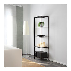 Two glass shelving units from Ikea