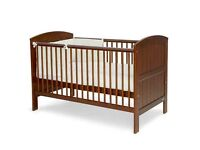 Mamas & Papas Cot - dark brown Oak with wear & tear scratch marks. Flat packed with all the bolts