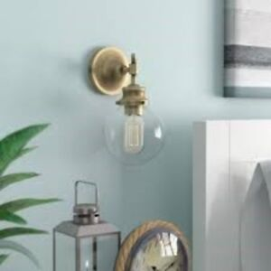 NEW  One Light Wall Sconce Natural Brass in original REG$110.00