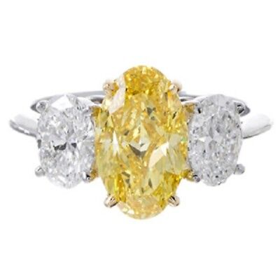Marvelous Fancy Yellow 2.05 CTW Oval cut Diamond GIA certified 18K White Gold