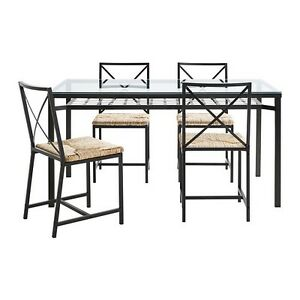 Dinning glass table with its 4 chairs and coffee table
