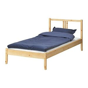 Single bed with nights stand and book self