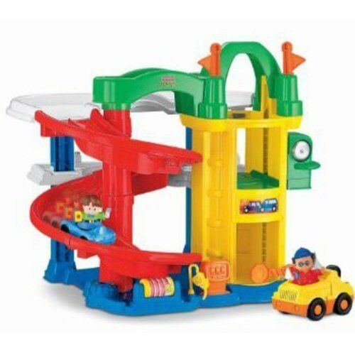 Fisher Price garage with vehicles