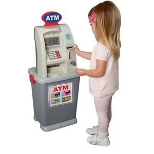 My ATM toy - like new - like the real thing! Comme neuve!