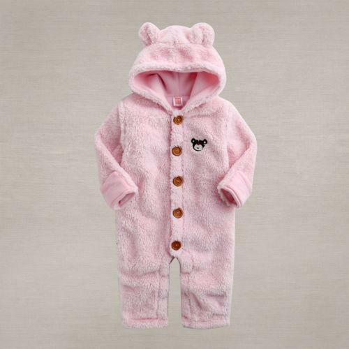 This fleece snowsuit is in great, like-new condition. It's chocolate brown, so suitable for infant boys or girls. The sleeves and ankles feature a folding closure (the fabric can be folded over the opening), so they will keep baby's hands and feet warm and protected from exposure.