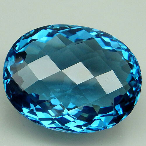 29.7CT. SEDUCTIVE!!! BLUE TOPAZ OVAL WITH CHECKERBOARD TABLE