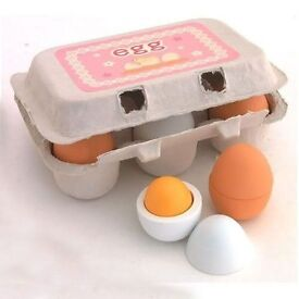 Wooden toy eggs for use in play kitchen