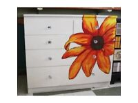 Large chest of drawers with floral design