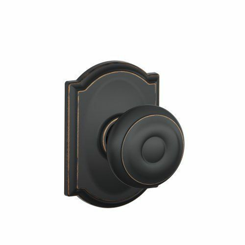 716 cam stands out as part of the camelot collection a pushbutton lock provides privacy for use with bathrooms and bedrooms this schlage door knob