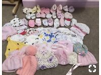 Bundle of baby hats and mittens
