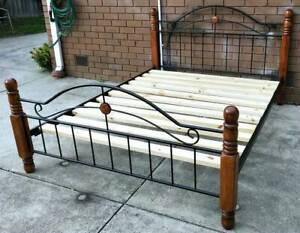 metal and timber frame queen bed with mattress