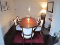 Oval Extending Mahogany Dining table and 6 carver chairs