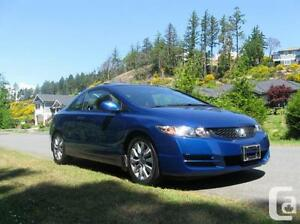 Selling my blue Honda Civic DX coupe 2010