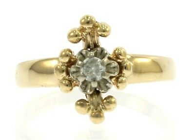 Ladies Diamond Cross Ring in 14 kt Yellow Gold.