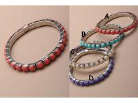 Pastel coloured opaque stone stretch bracelet. - JTY128