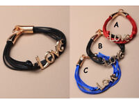 "Multi strand corded ""love"" bracelet. In an assortment of red,black and blue - JTY084"