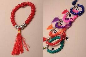 Coloured bead stretch bracelet with tassle and peace bead - JTY081