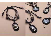 Multi strand black corded bracelet with black charm pendant. In 4 designs. - JTY113