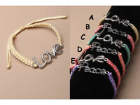 "Coloured cord friendship bracelet with either Love or ""Peace charm."" - JTY132"