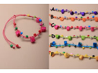 Brightly coloured square shell and beaded cord bracelet. - JTY130