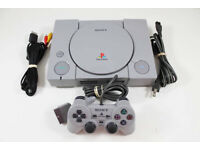 PlayStation 1 console (grey model) unboxed with 1 power lead/1 scart lead/1 ps1 controller & games