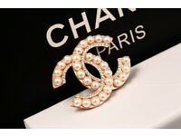 CC Chanel brooch and earrings