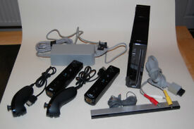 Black Nintendo Wii with two controllers + 4 games