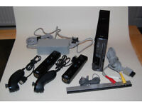 Black Nintendo Wii with two controllers + a few games
