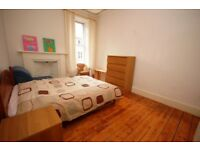 Spacious 2nd floor 2 bedroom flat with open-plan lounge/kitchen in Tollcross available June