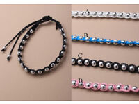 Silver coloured bead corded friendship bracelet. Assortment of blue/pink/white and black - JTY029