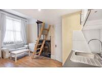 A spacious studio flat, open plan fitted kitchen, mezzanine sleeping area in SW3