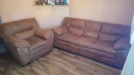 3 Seater sofa and Armchair in brown real leather.